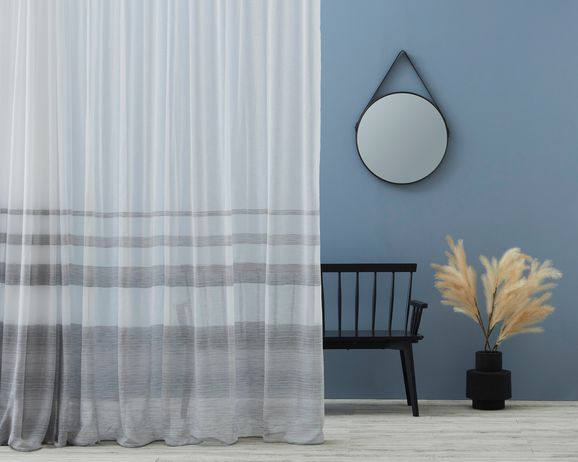 Photo of the fabric Nicoya Gris in situ by Zepel. Use for Sheer Curtains. Style of Decorative, Pattern, Sheer, Stripe